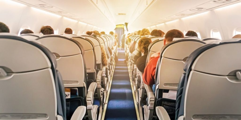 passengers sat in airplane