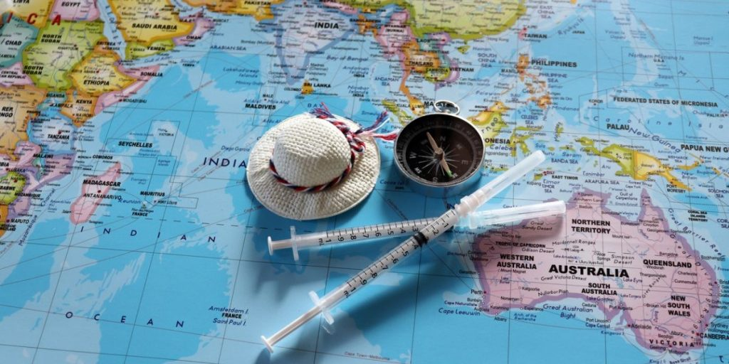 world map and syringes