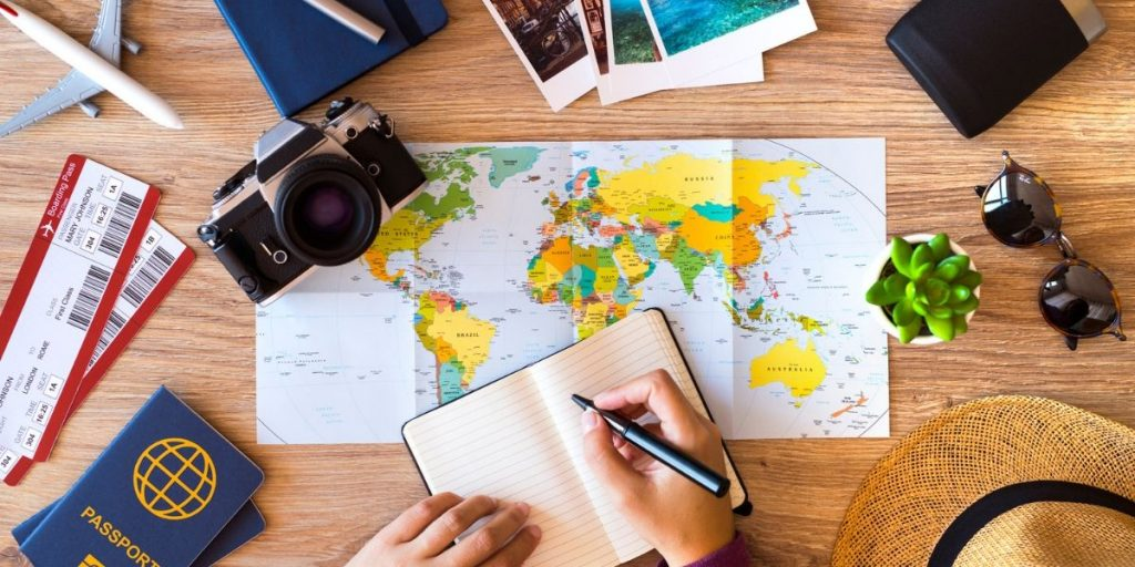 world map with travel essentials