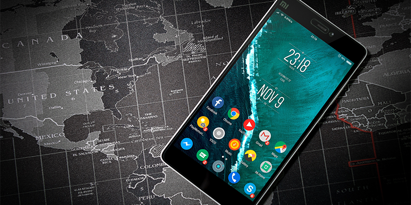 Mobile Phone Showing Popular Apps On A Map