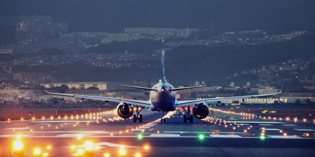 plane landing during the evening